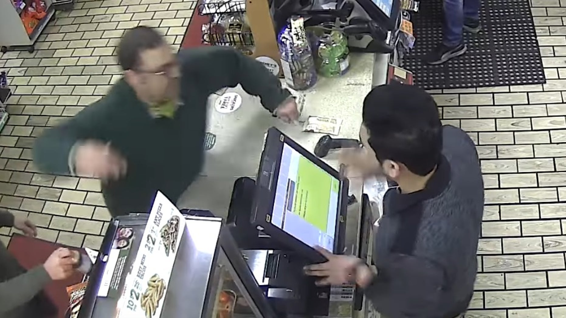 The customer throwing a punch.