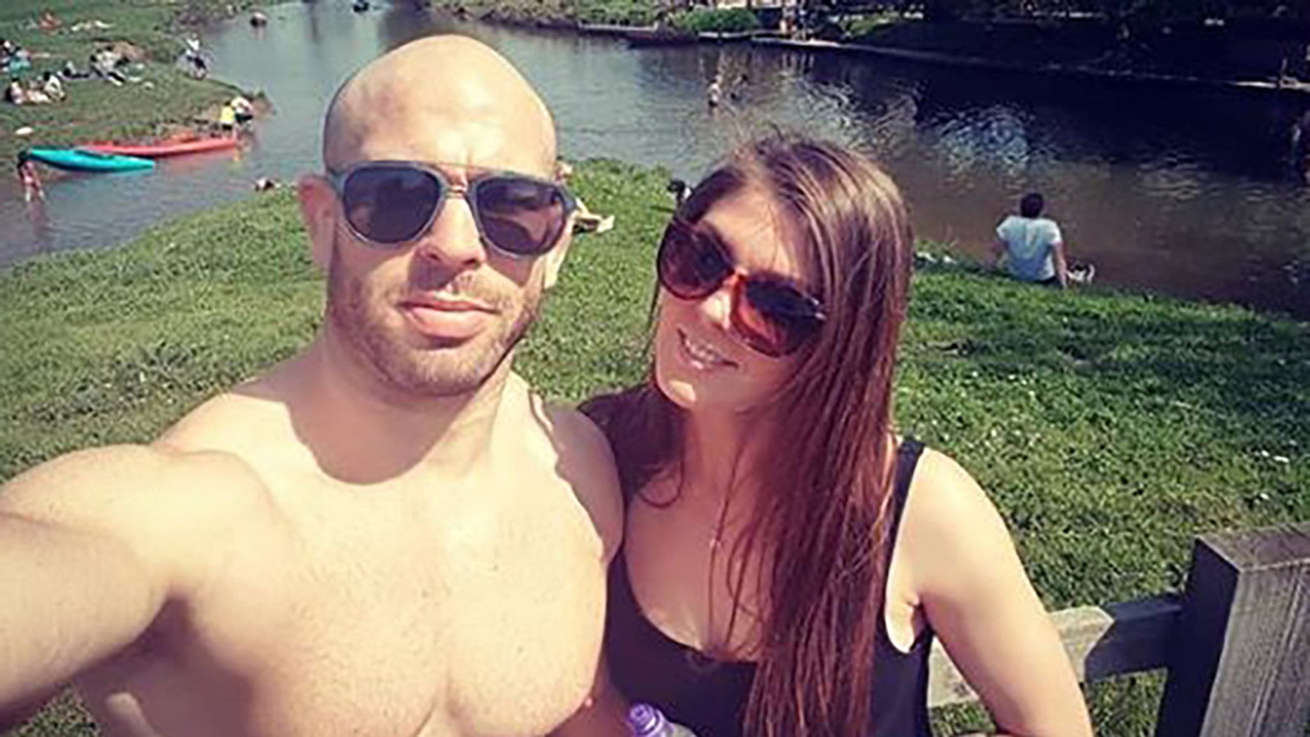 MMA fighter Jack Mason, left, poses with his wife. Mason suffered a nasty cut to his eye at an event in Sweden.