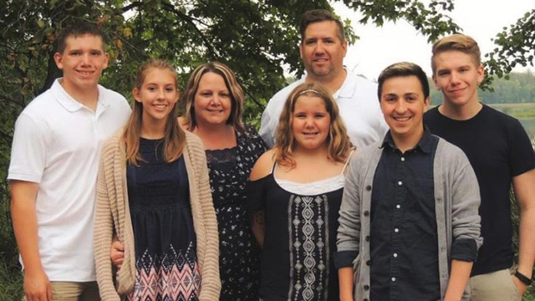 This undated photo shows the Peterson family of Ada, Minn. Carter Peterson, far left, was killed in a car crash that Randy, third from right, responded to as a volunteer firefighter