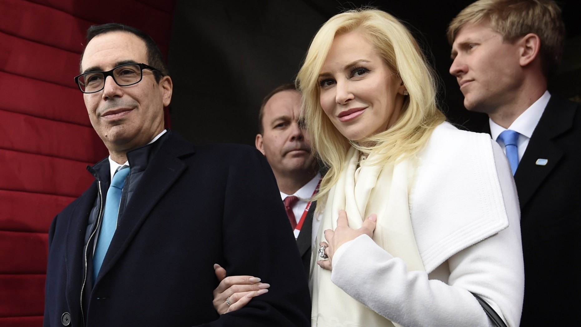 In this Friday, Jan. 20, 2017, file photo, Treasury Secretary-designate Stephen Mnuchin and his fiancee, Louise Linton, arrive on Capitol Hill in Washington, for the presidential inauguration of Donald Trump.