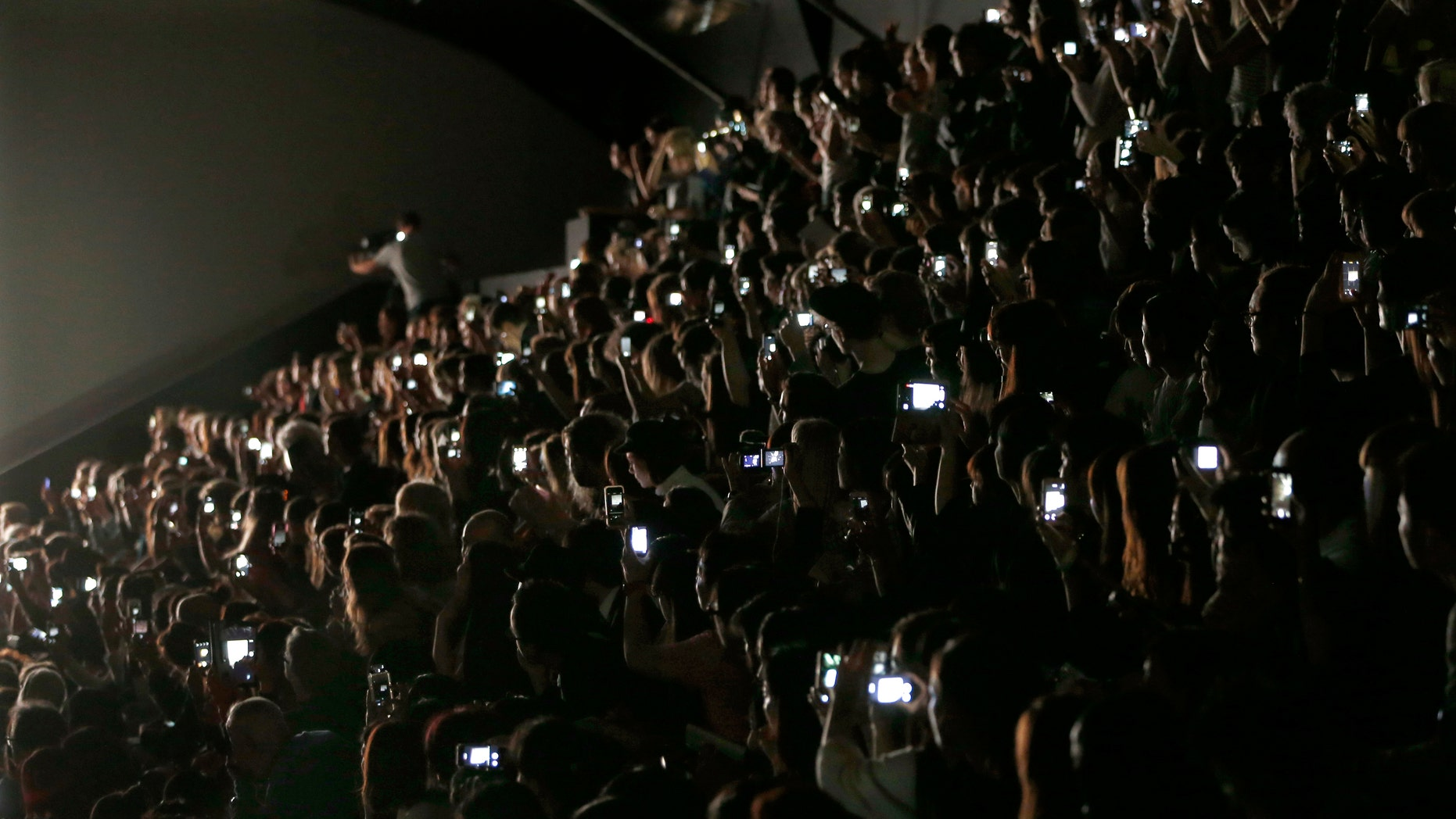 Guests and journalists take picture with their mobile phones during Japanese designer Yoshiyuki Miyamae Spring/Summer 2015 women's ready-to-wear collection show for fashion house Issey Miyake during Paris Fashion Week September 26, 2014.    REUTERS/Charles Platiau  (FRANCE - Tags: FASHION) - RTR47T3X