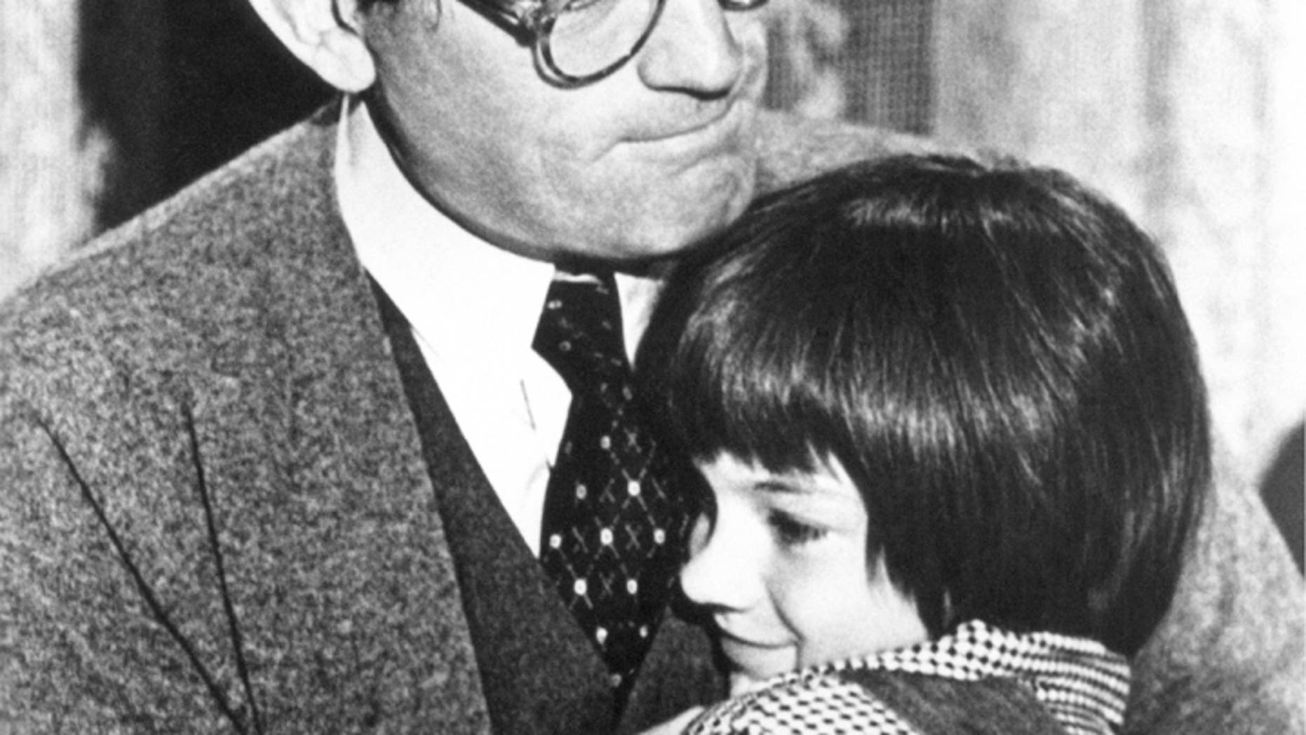 """Gregory Peck embraces Mary Badham, 9, who plays his daughter in the 1963 movie """"To Kill a Mockingbird."""""""