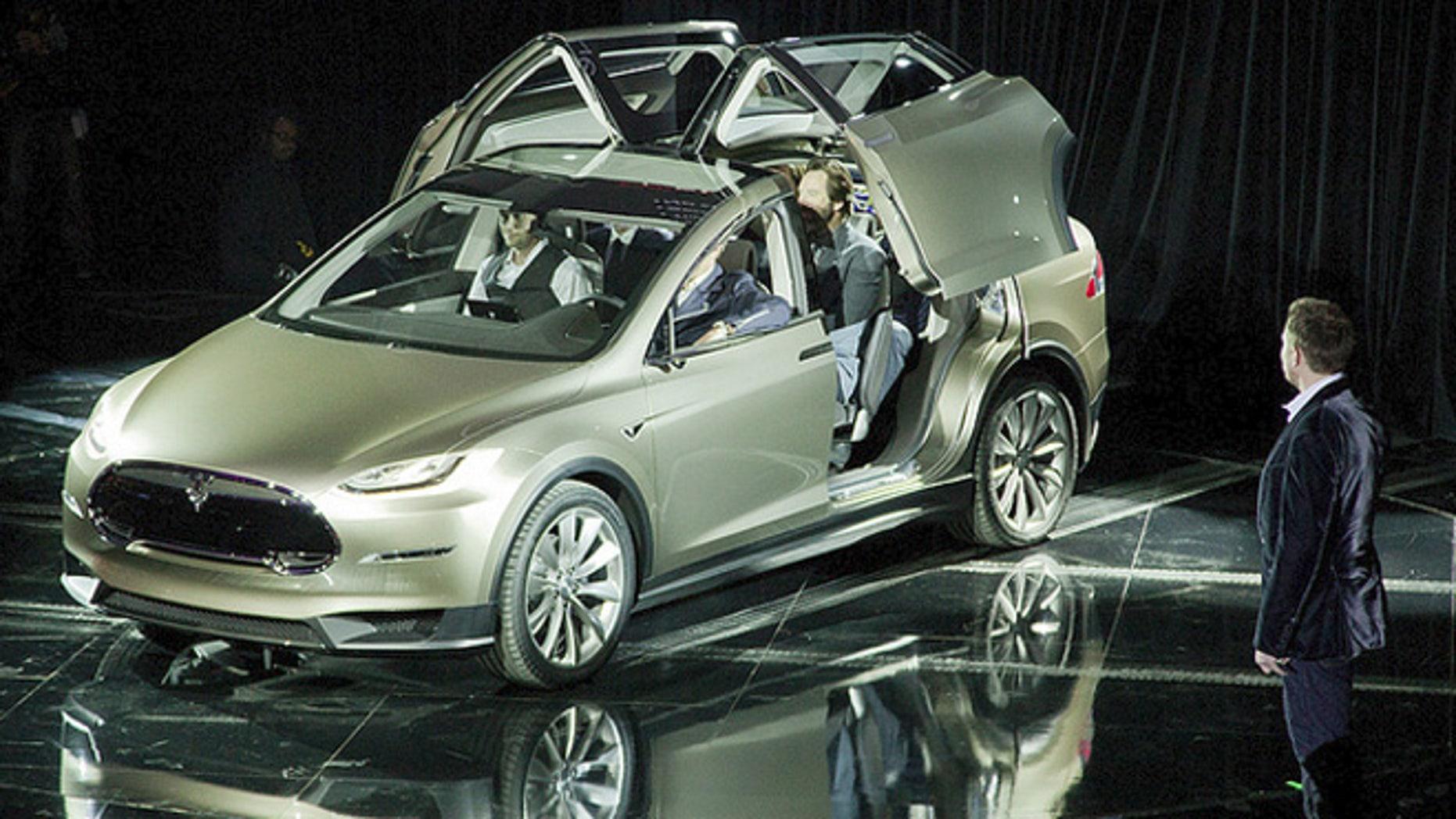 Elon Musk reveals Tesla Model X crossover concept