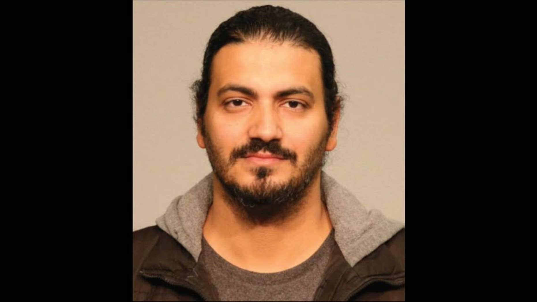 Mohamed Mahmoud, 37, faces a list of weapons-related charges in connection with Saturday's shooting, authorities say.