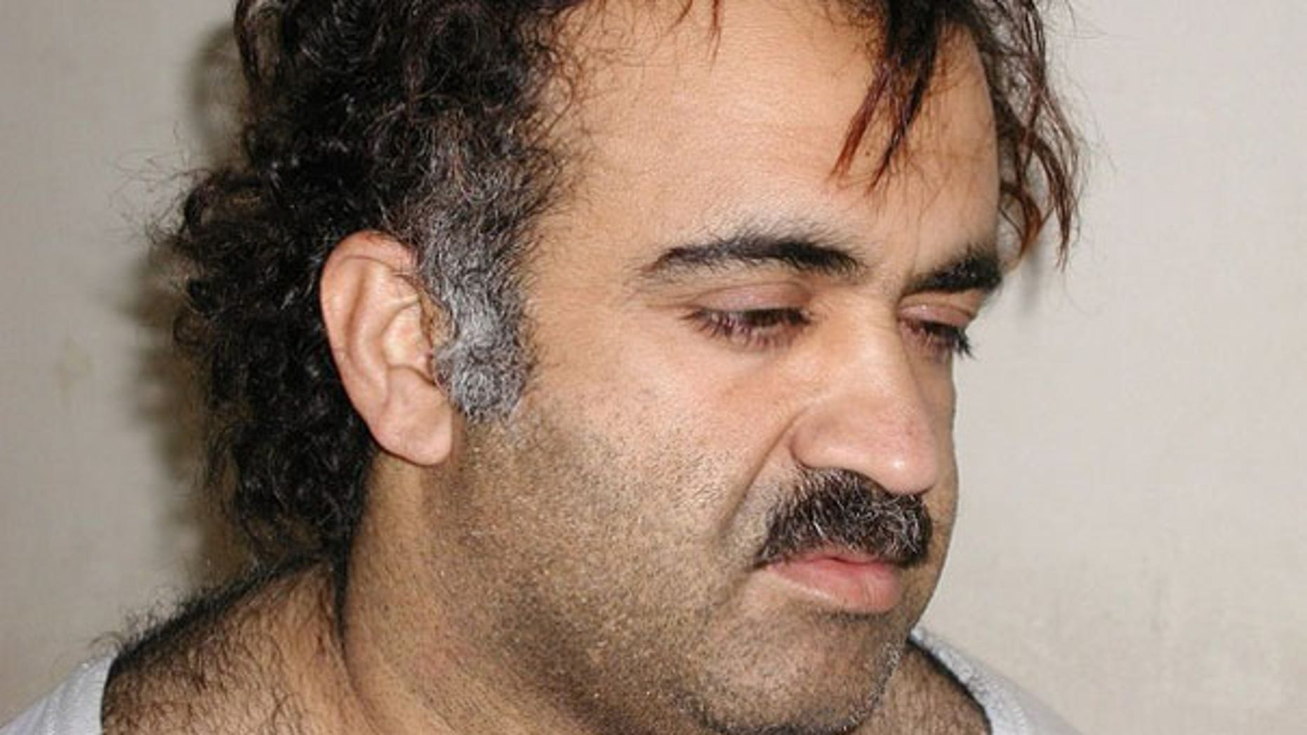 Khalid Sheikh Mohammed is shown in this file photograph during his arrest on March 1, 2003. (Reuters Photo)