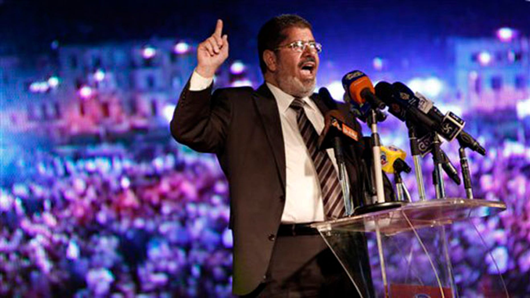 May 20, 2012: In this file photo, Muslim Brotherhood's president-elect Mohammed Morsi speaks at his last rally in Cairo, Egypt.