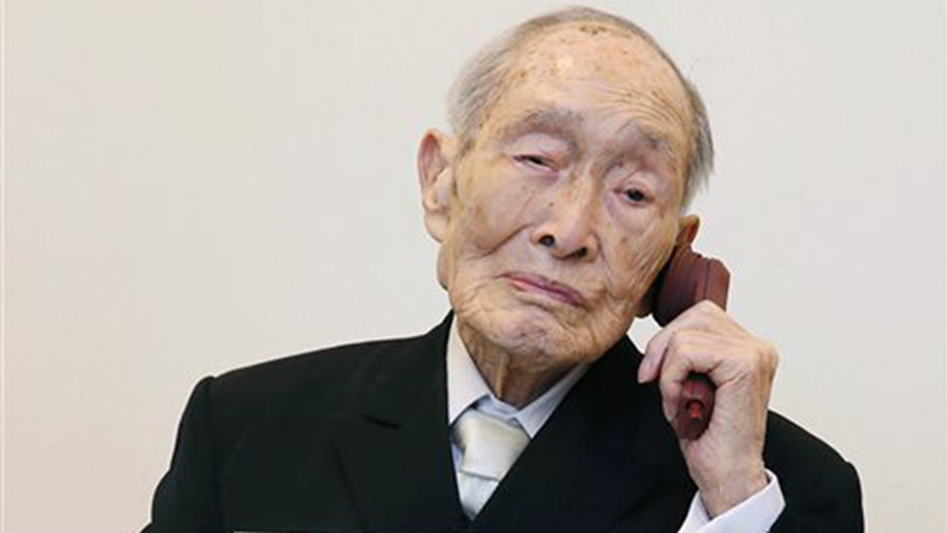 In this Aug. 20, 2014 file photo, Sakari Momoi, a Japanese retired educator, poses for a photo in Tokyo.