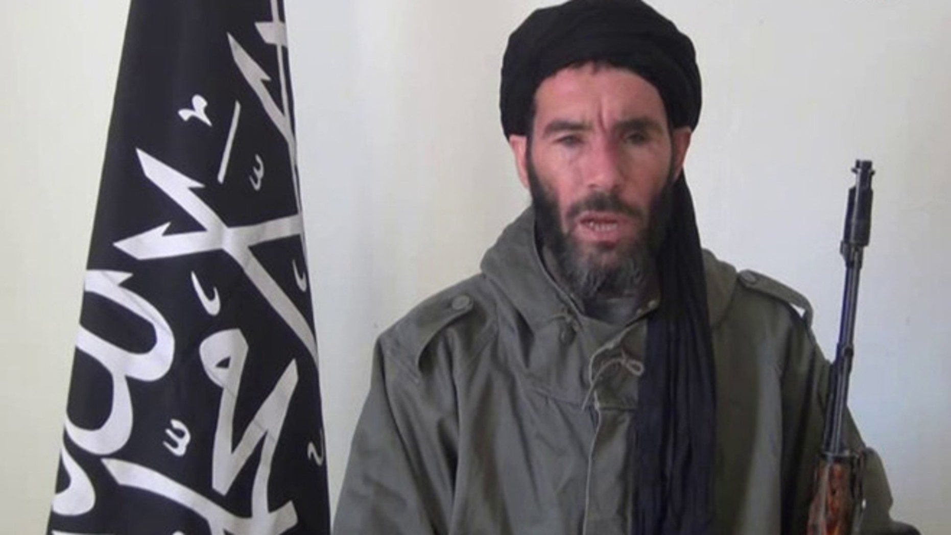 Jan. 17, 2013: In this undated file image taken from video provided by the SITE Intel Group and made available, purports to show terrorist leader Moktar Belmoktar. The one-eyed terror leader Moktar Belmoktar, who is considered by many to be the most dangerous man in the Sahara, is now officially joining forces with a Mali-based jihadist group and vowing to stage attacks in Egypt, according to a statement posted Thursday, Aug. 22, 2013 on a Mauritanian web site.