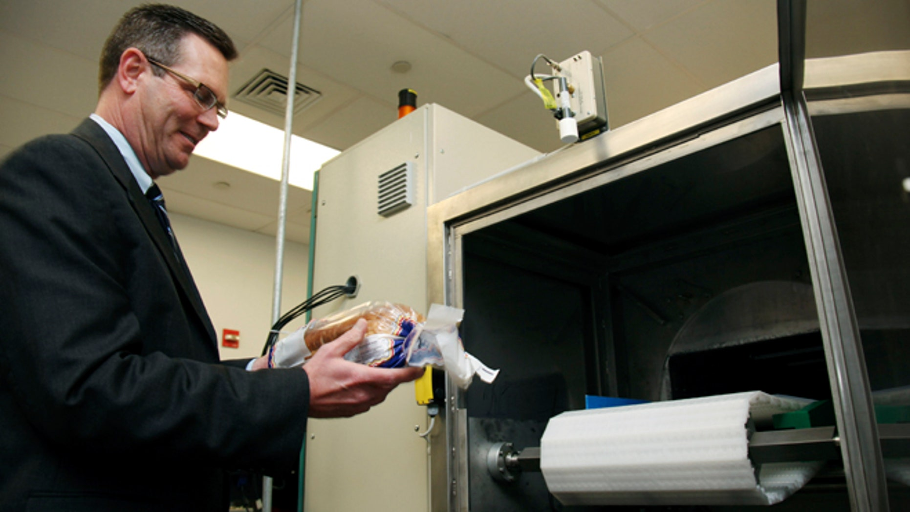 Dec. 6, 2012: Don Stull, chief executive officer of Microzap, Inc., places a loaf of bread inside a patented microwave that kills mold spores in Lubbock, Texas. The company claims the technology allows bread to stay mold-free for 60 days. (AP)