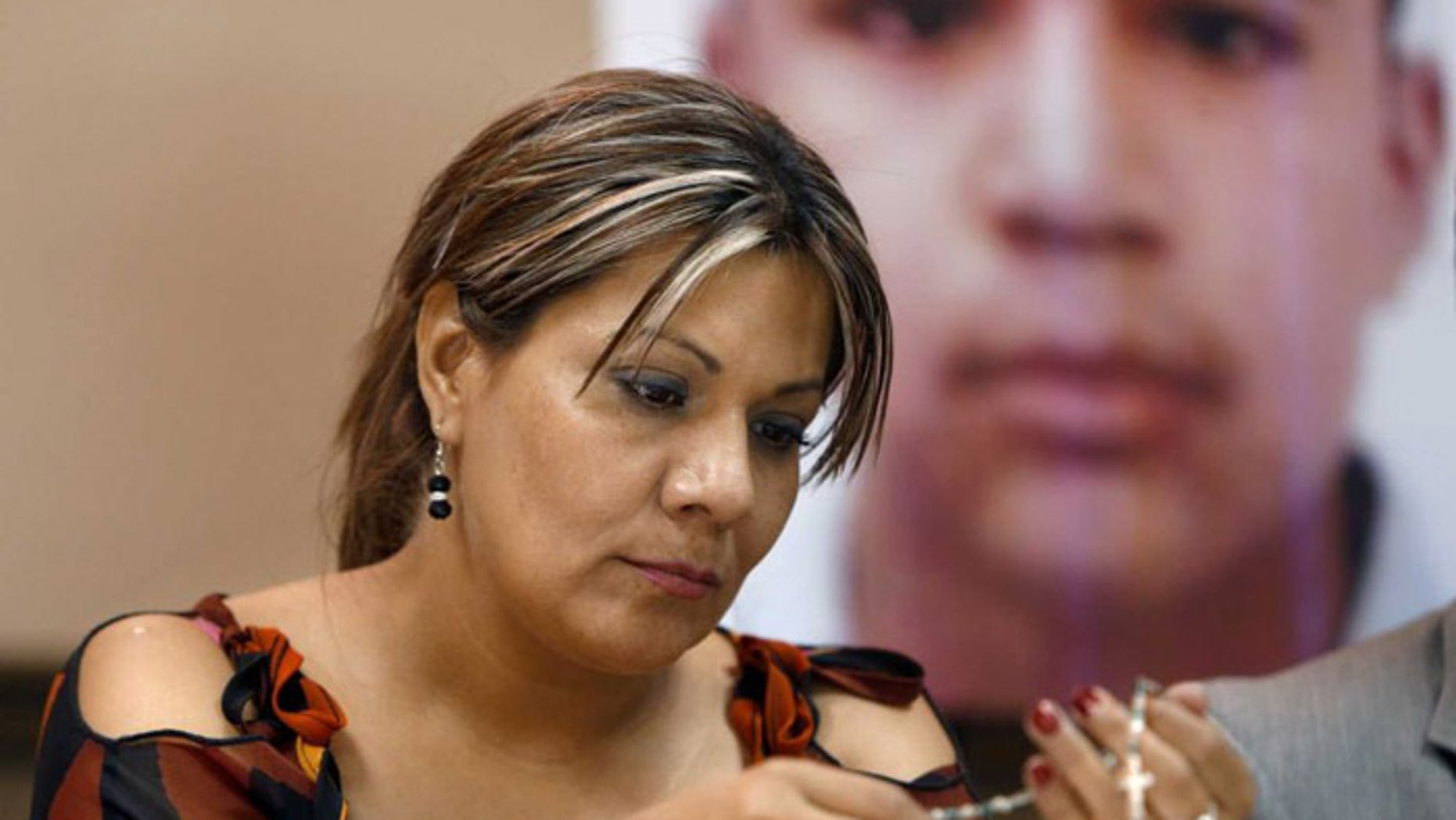Araceli Rodriguez, whose son, son Jose Antonio Elena Rodriguez, pictured behind her, was shot and killed by U.S. Border Patrol agent in October 2012. (AP)