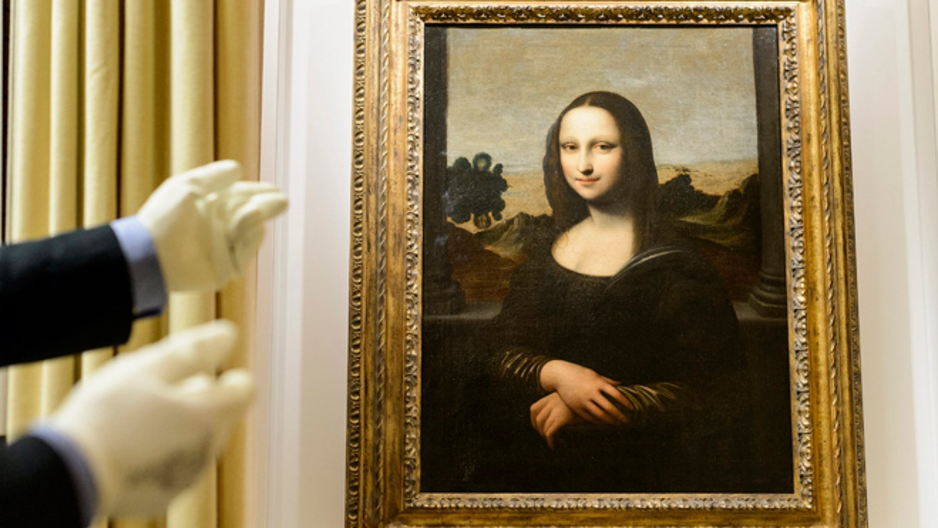 Sept. 26, 2012: A painting attributed to Leonardo da Vinci and representing Mona Lisa is seen during a preview presentation in a vault in Onex near Geneva.