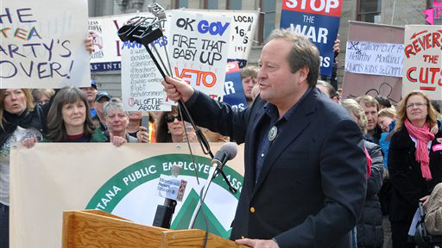 Montana Gov. Brian Schweitzer speaks in front of a crowd of protesters outside the Capitol in Helena, Mont., on April 1.