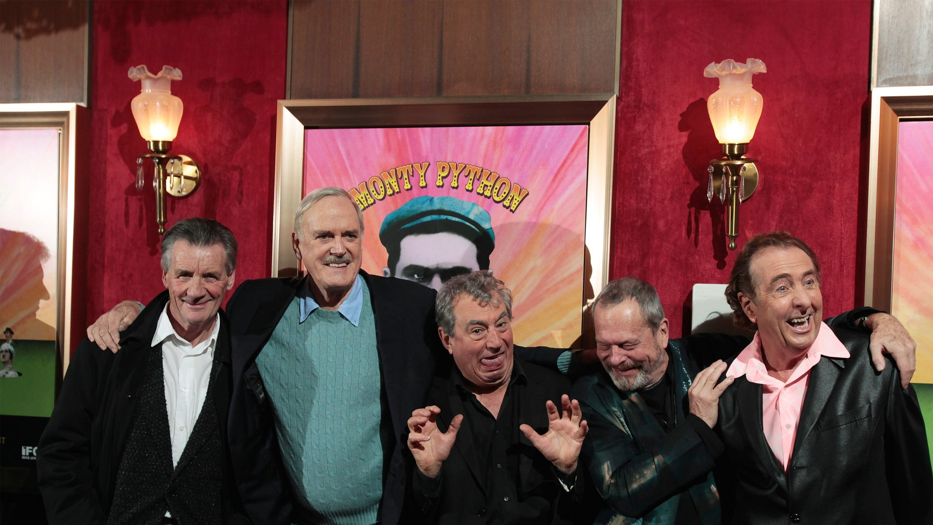 """(Left to right) The original cast of the Monty Python troupe Michael Palin, John Cleese, Terry Jones, Terry Gilliam and Eric Idle smile as they arrive at the premiere of the documentary """"Monty Python: Almost The Truth (Lawyer's Cut)"""" celebrating the troupe's 40th anniversary, in New York October 15, 2009."""