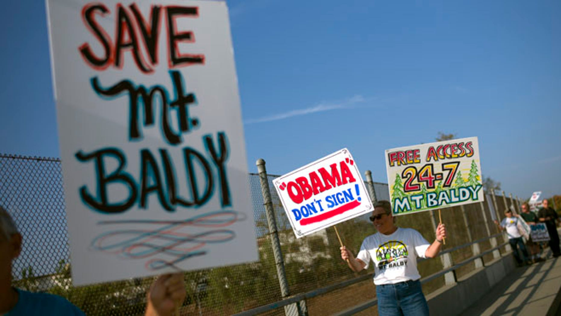 Oct. 10, 2014: Protesters hold signs to oppose President Barack Obama's designation of the San Gabriel Mountains as a national monument before Obama's visit to Frank G. Bonelli Regional Park in San Dimas, Calif.