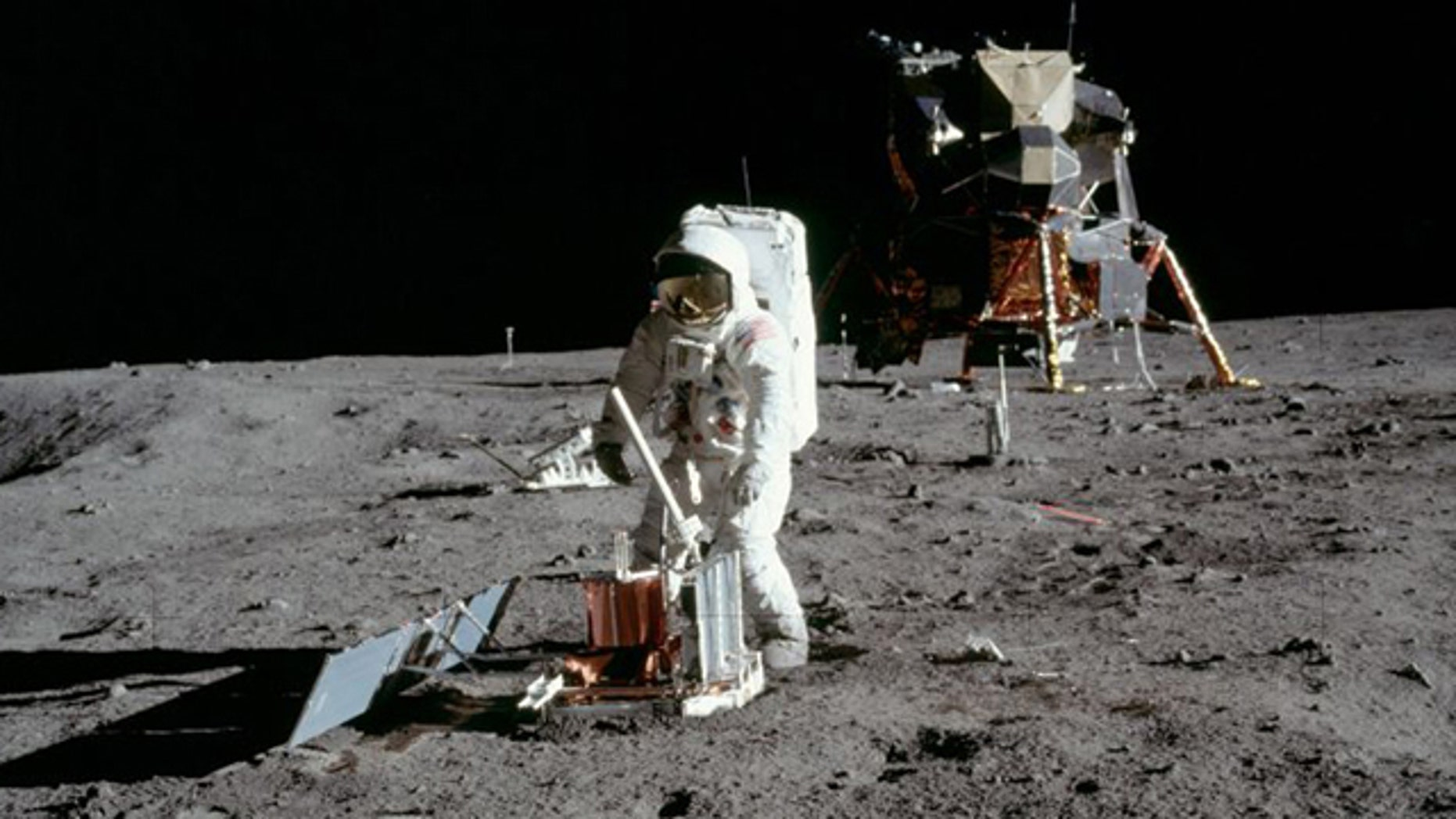 Buzz Aldrin deploys a seismometer in the Sea of Tranquillity area of the moon.
