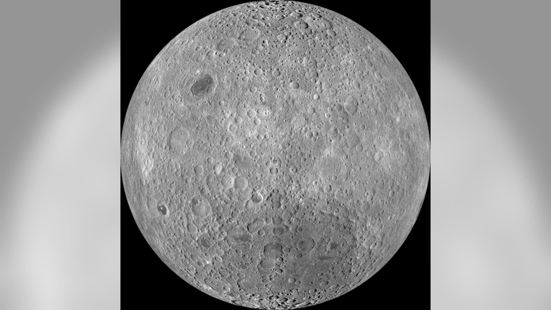 """The far side of the moon, often mistakenly called the """"dark side"""" though it receives just as much sunlight as the near side, as imaged by NASA's Lunar Reconnaissance Orbiter."""