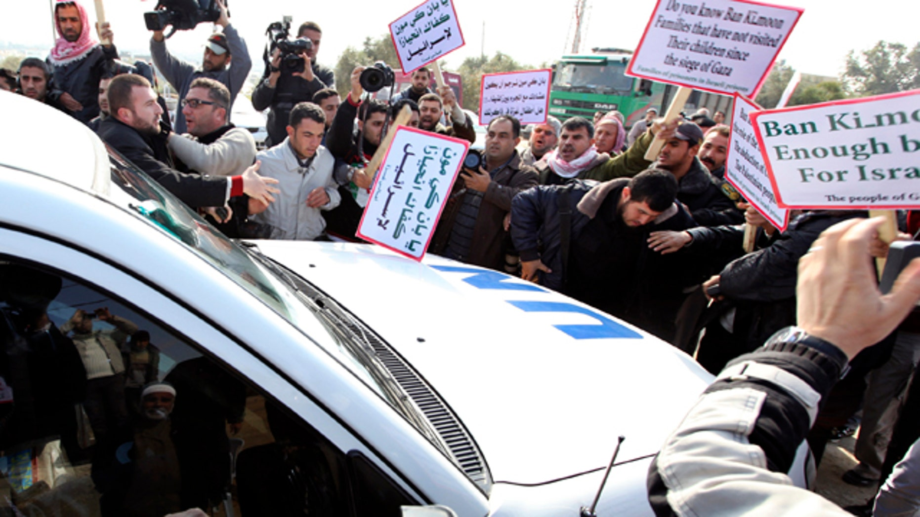 Feb. 2: Palestinian protesters surround a vehicle in the convoy of U.N. Secretary-General Ban Ki-moon as it arrives at Erez border crossing between Israel and Gaza.