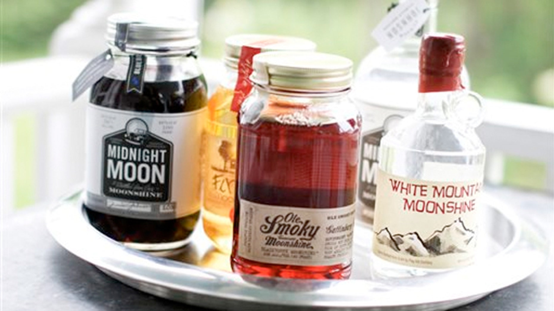 June 10, 2013: Midnight Moon Blueberry, FireFly Moonshine Apple Pie Flavor, Ole Smoky Tennessee Moonshine Blackberry, Midnight Moon Moonshine, and White Mountain Moonshine are shown in Concord, N.H.
