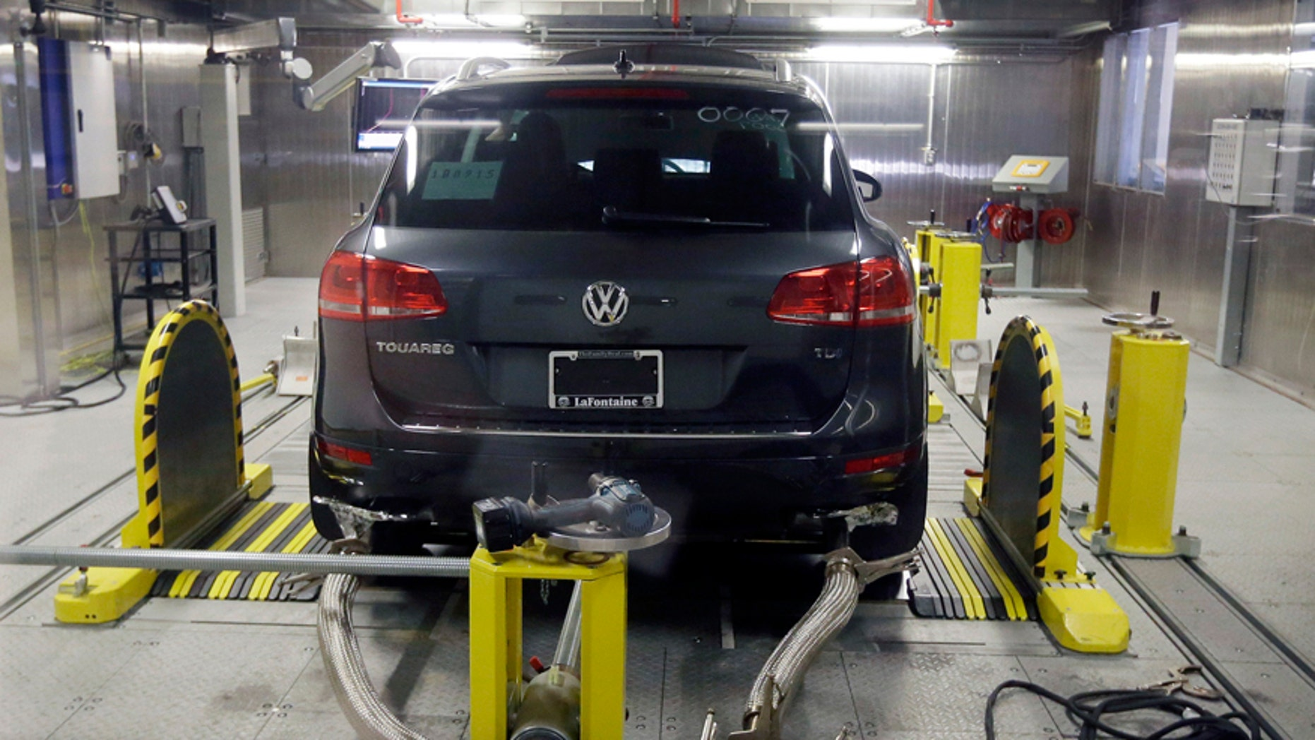 FILE - In this Oct. 13, 2015 file photo, a Volkswagen Touareg diesel is tested in the Environmental Protection Agency's cold temperature test facility in Ann Arbor, Mich. The U.S. government says Volkswagen cheated a second time on emissions tests, programming about 10,000 cars with larger diesel engines, including the 2014 Touareg, 2015 Porsche Cayenne and the 2016 Audi A6 Quattro, A7 Quattro, A8 and Q5, to emit fewer pollutants during testing than in real-world driving conditions. (AP Photo/Carlos Osorio, File)
