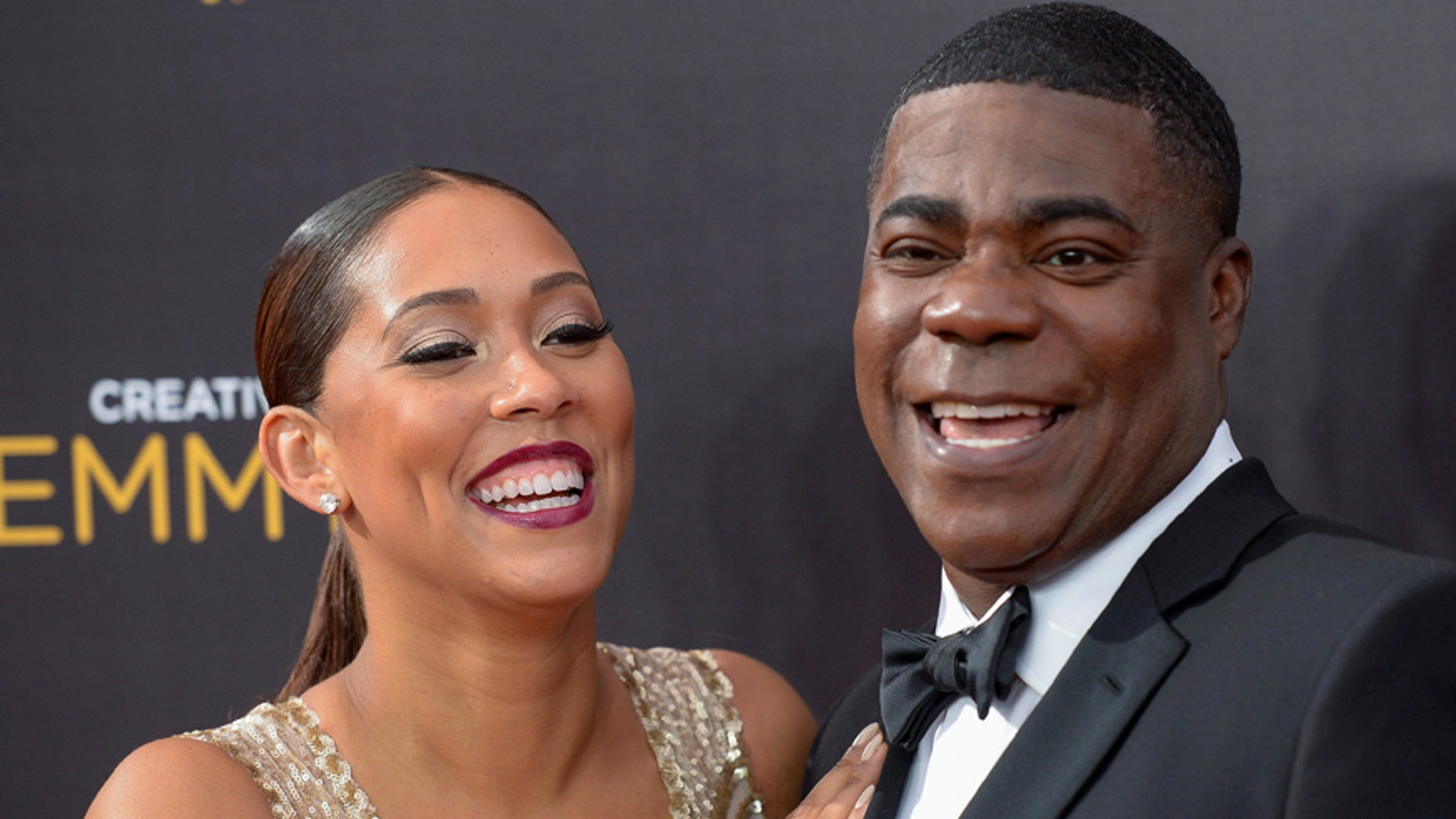Morgan and wife actress Megan Wollover arrive at the Creative Arts Emmys