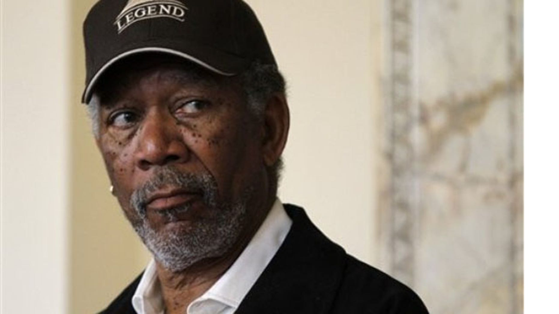 Actor Morgan Freeman listens during a news conference at Symphony Hall, in Boston, Tuesday, May 18, 2010.