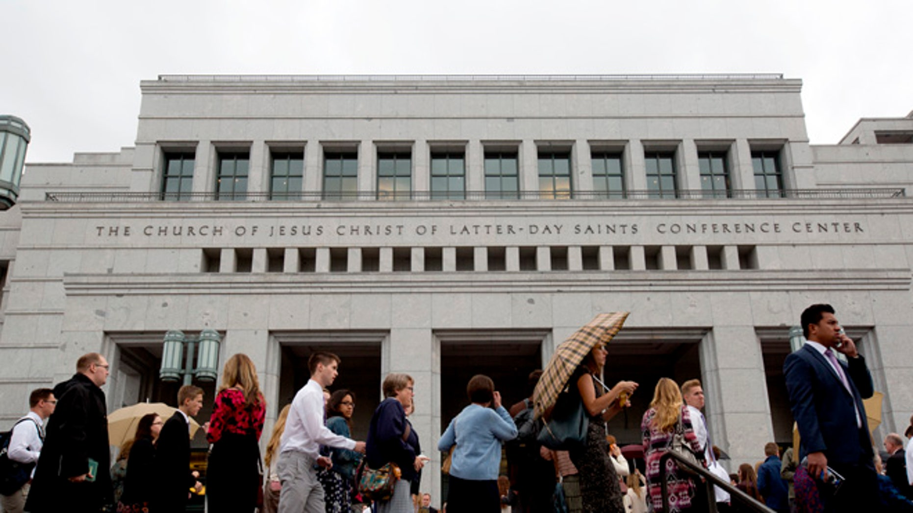 People arrive for the opening session of the two-day Mormon church conference at the LDS Conference Center, Saturday, Oct. 3, 2015, in Salt Lake City. As many as three new high-ranking Mormon leaders could be named during the weekendâs church conference to fill vacancies on a governing body that sets church policy and run the faithâs business operations.  (AP Photo/Kim Raff)