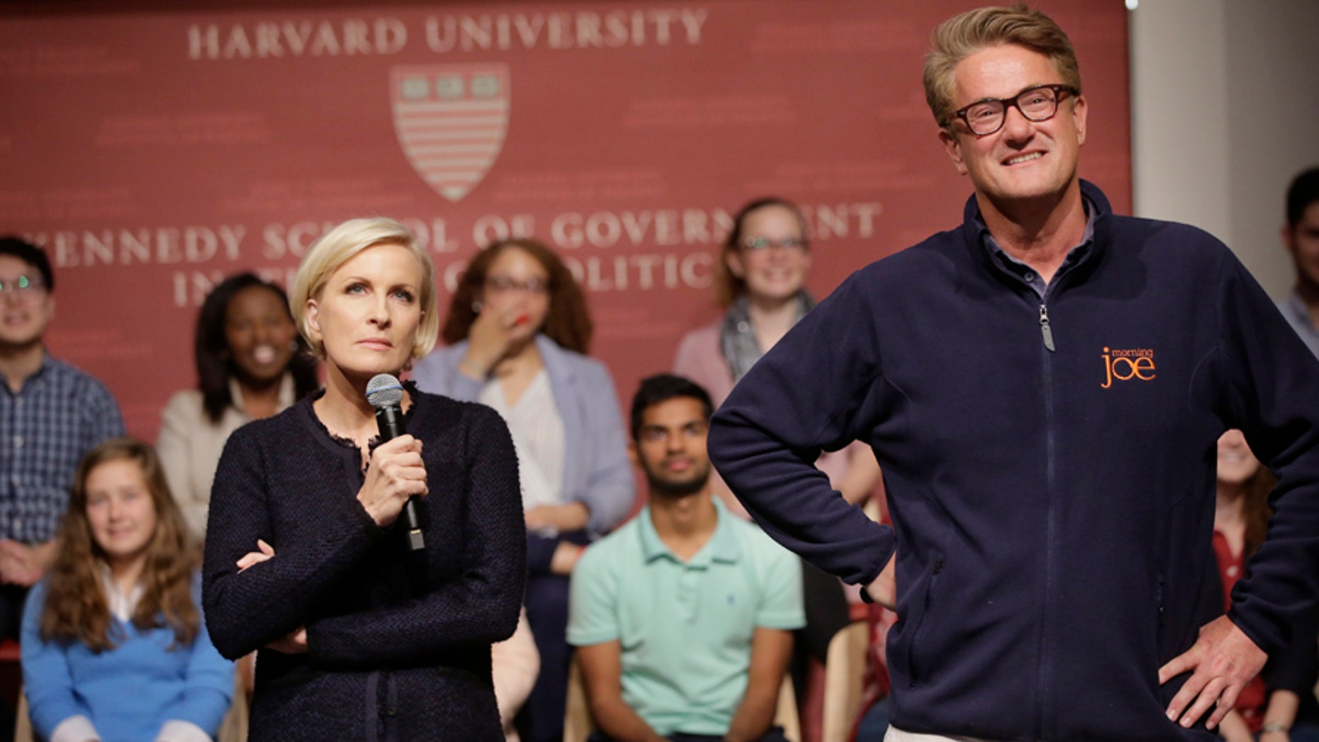 """MSNBC television anchors Mika Brzezinski, left, and Joe Scarborough, right, co-hosts of the show """"Morning Joe,"""" take questions from an audience, Wednesday, Oct. 11, 2017, at a forum called Harvard Students Speak Up: A Town Hall on Politics and Public Service, at the John F. Kennedy School of Government, on the campus of Harvard University, in Cambridge, Mass. (AP Photo/Steven Senne)"""
