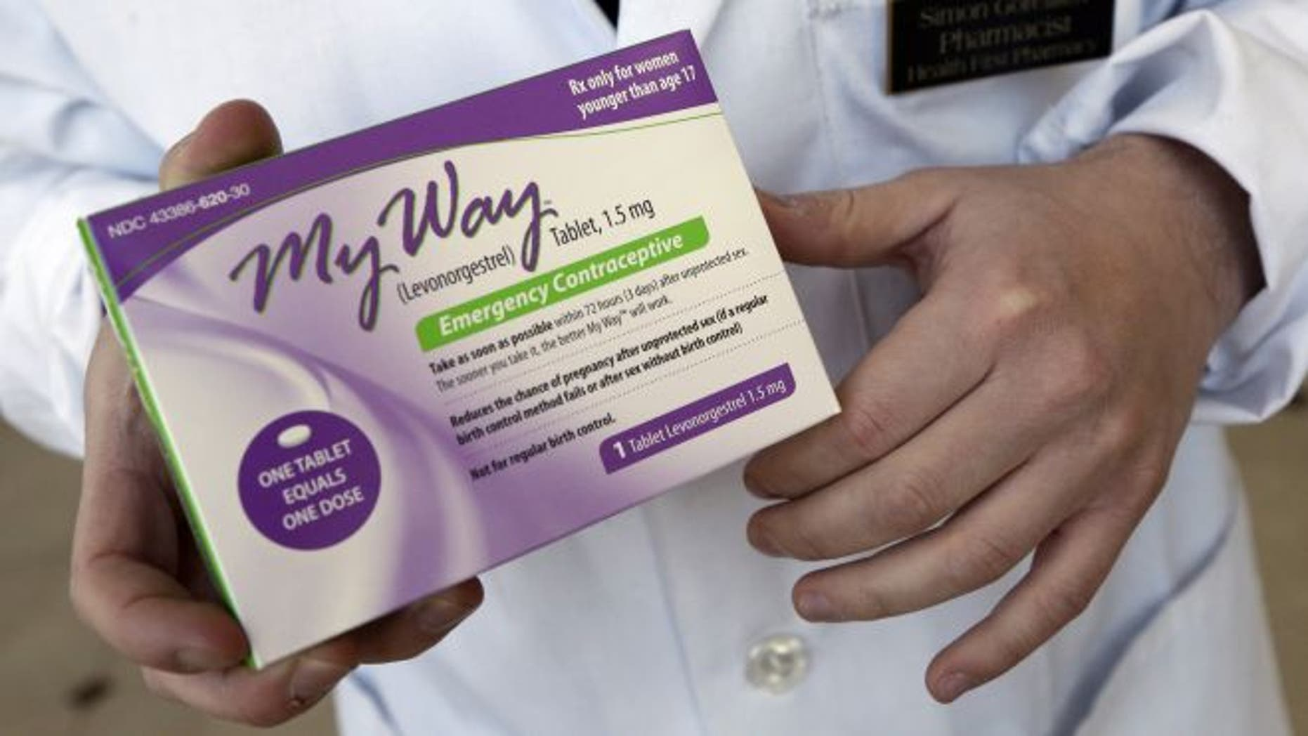 May 2, 2013 file photo, pharmacist Simon Gorelikov holds a generic emergency contraceptive at the Health First Pharmacy in Boston.