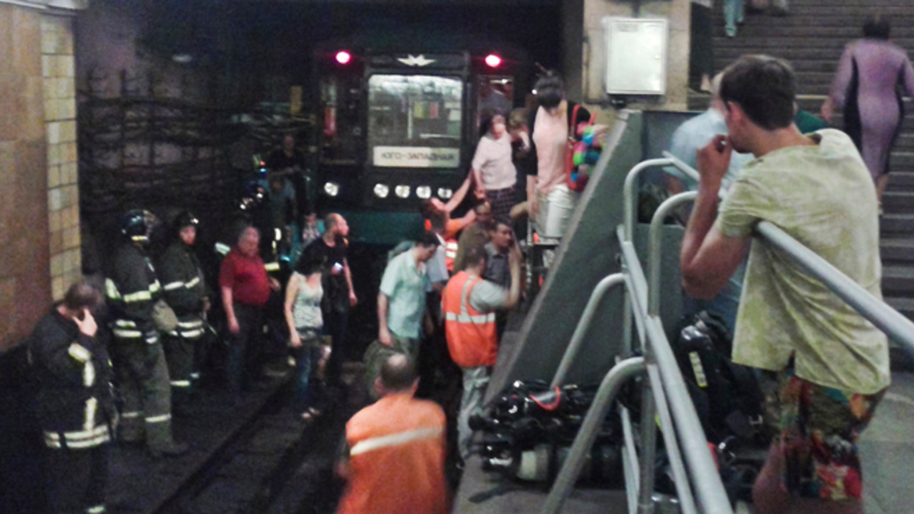 June 5, 2013: In this image made by a mobile phone camera, people leave a subway station in downtown Moscow.. A rush-hour fire in Moscows subway injured dozens of people, forced the evacuation of thousands of commuters and closed parts of the network on Wednesday, authorities said.