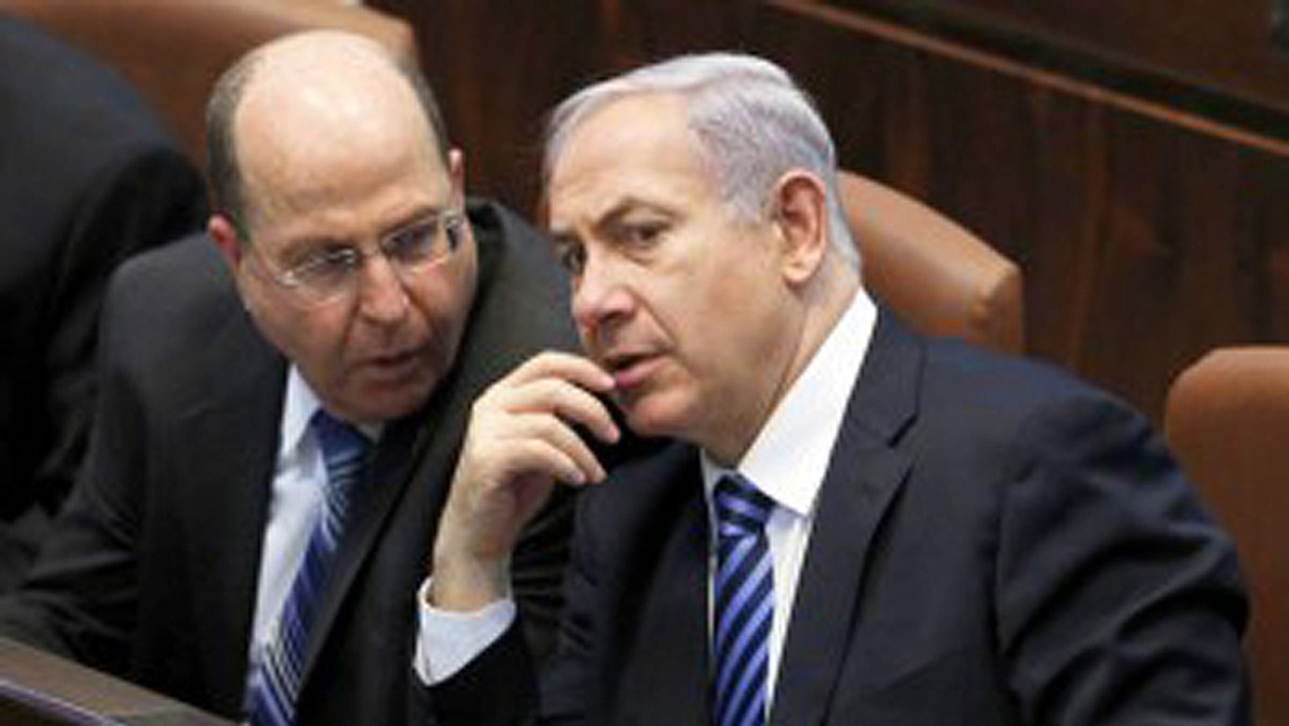 """What do they really think? Israeli Defense Minister Moshe Ya'alon, (l.), shown here with Prime Minister Benjamin Netanyahu, blasted U.S. Secretary of State John Kerry in what were supposedly """"private comments."""" (Reuters)"""
