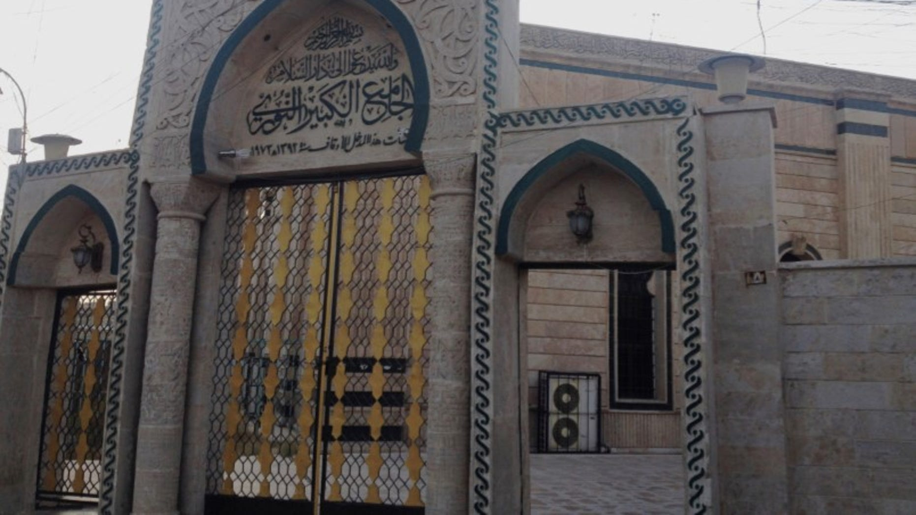 In this 2014 file photo, the gate of the Great Mosque or al-Nuri Mosque is seen in the northern city of Mosul, Iraq. The Islamic State group destroyed Mosul's al-Nuri mosque and its iconic leaning minaret late Wednesday night when fighters detonated explosives inside the structures, according to Iraq's Ministry of Defense.