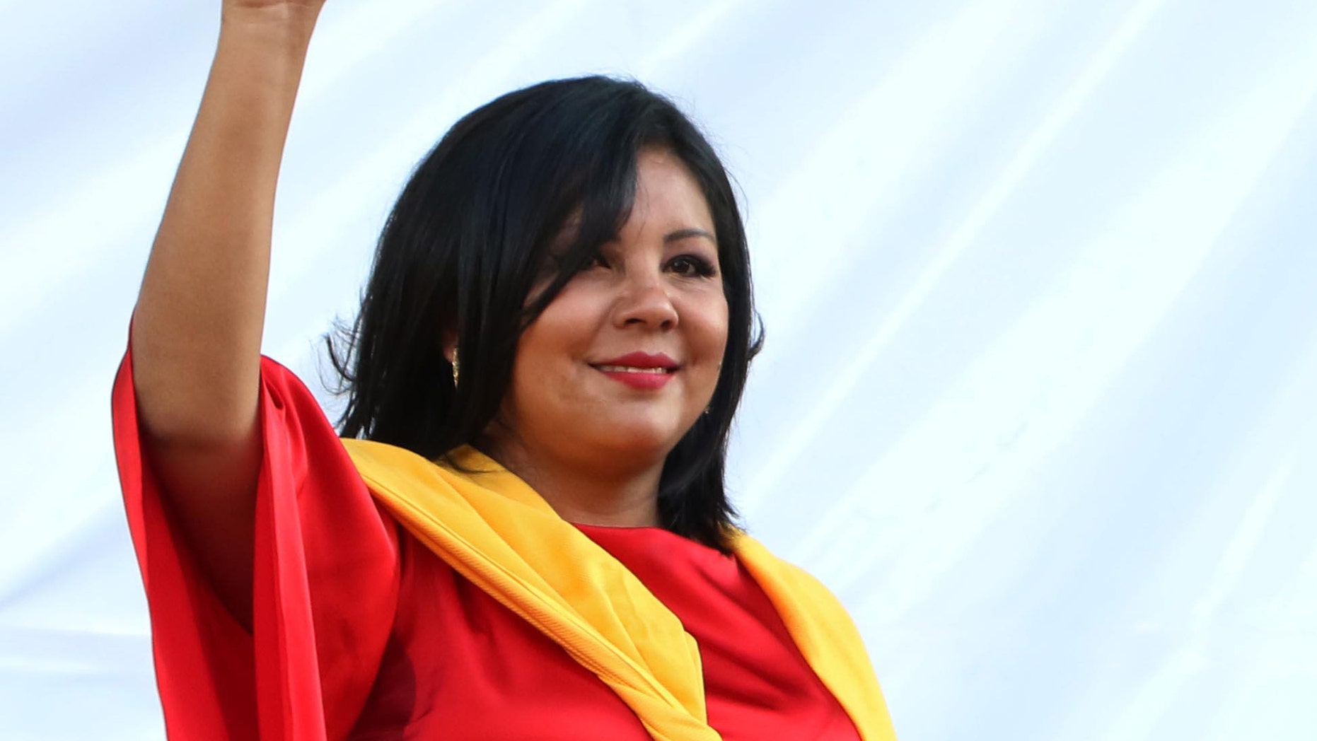 In this Friday, Jan. 1, 2016 photo, Gisela Mota waves during her swearing in ceremony as mayor of Temixco, Morelos State, Mexico. The Morelos state Public Security Commission says attackers invaded Mota's house on Saturday morning and killed her. (AP Photo/Tony Rivera)