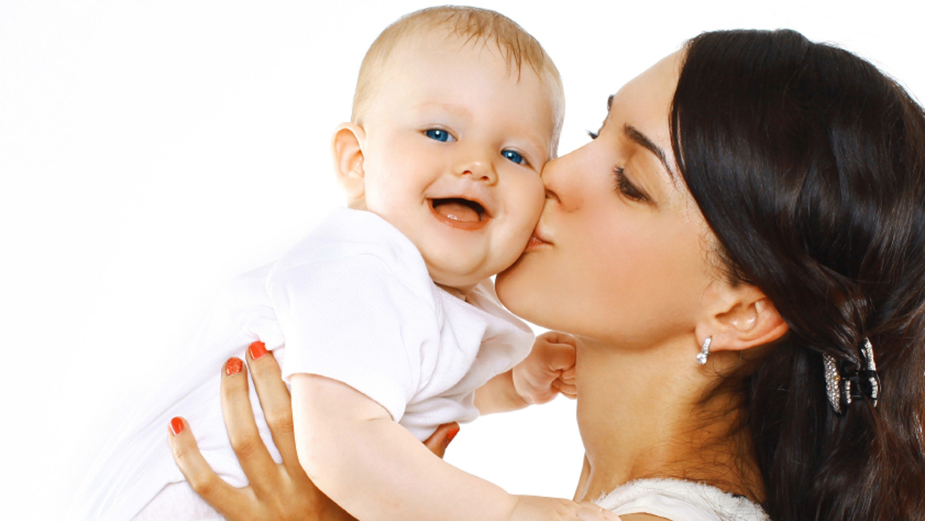 Happy family mother kissing baby