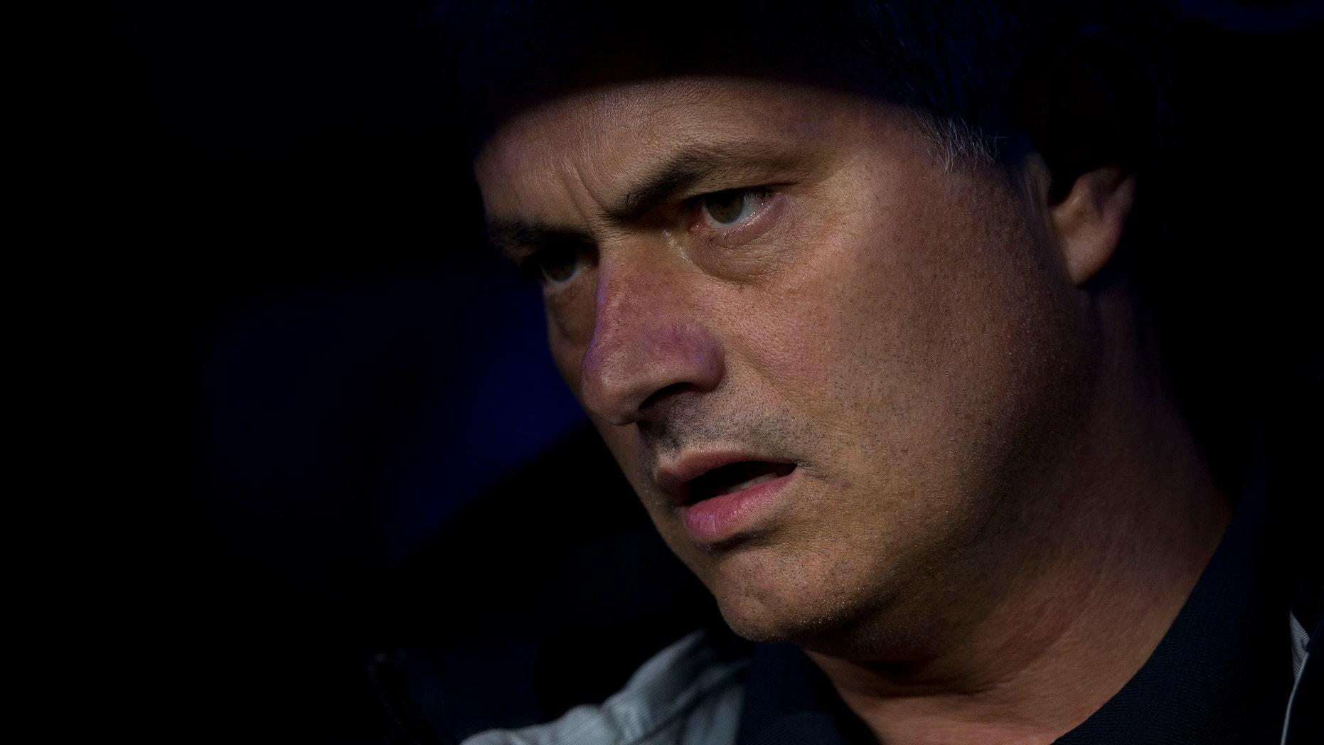 Real Madrid's coach Jose Mourinho from Portugal reacts during a Spanish La Liga soccer match against Malaga at the Santiago Bernabeu stadium, in Madrid, on Wednesday, May 8, 2013. (AP Photo/Daniel Ochoa de Olza)