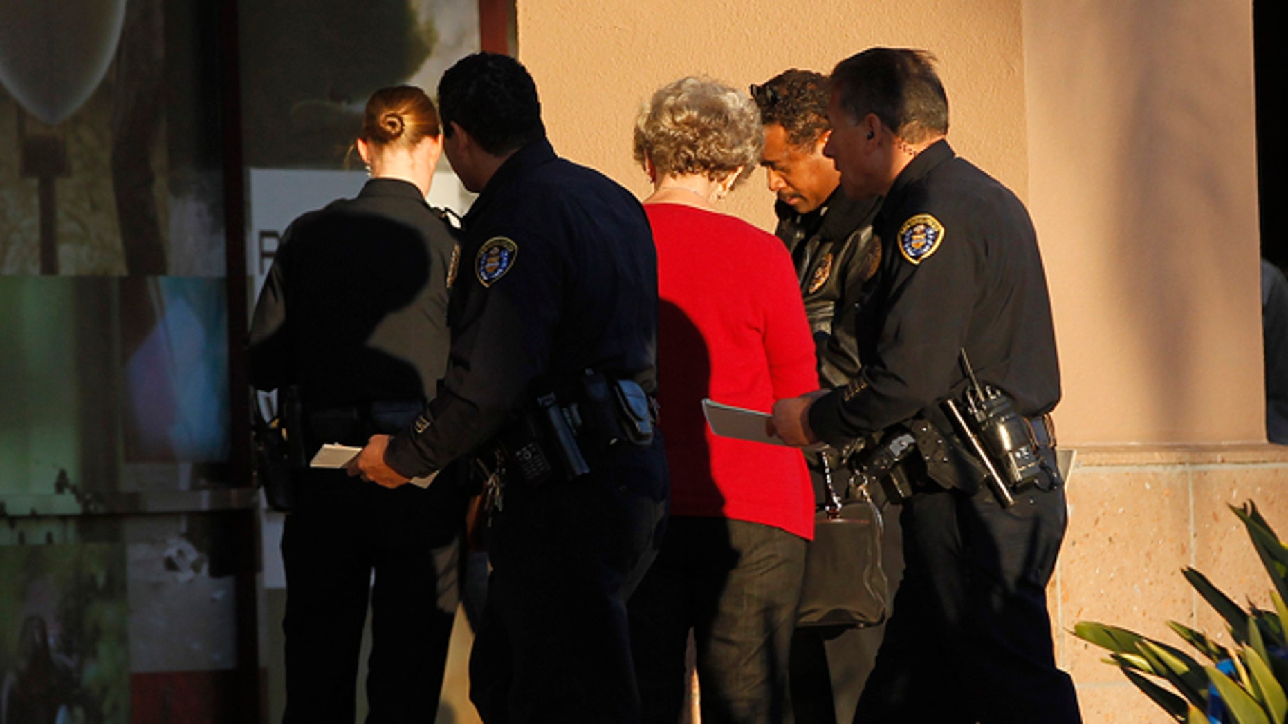 Jan. 12, 2013: Police officers talk with a witness near a shooting at the Reading Cinemas in San Diego.