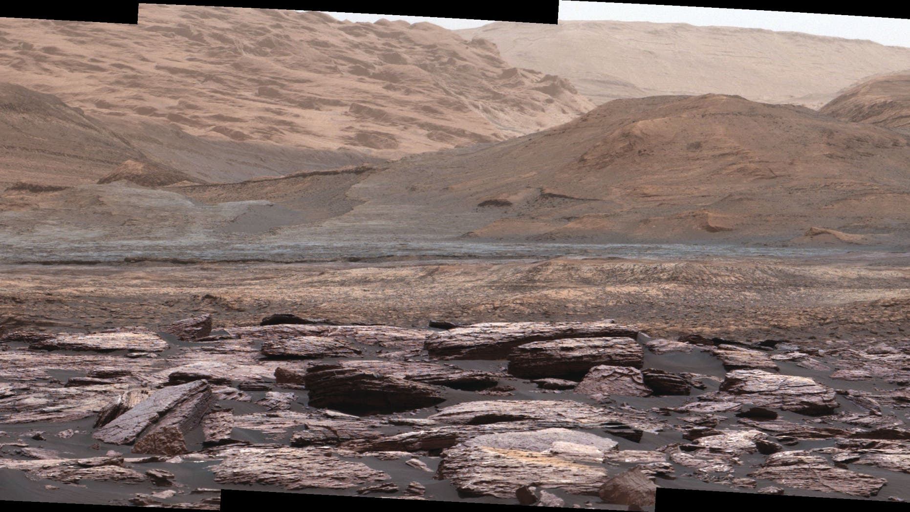 This new image from the Mars Curiosity rover captures purple-colored rocks on the surface of lower Mount Sharp. (Credit: NASA/JPL-Caltech/MSSS)