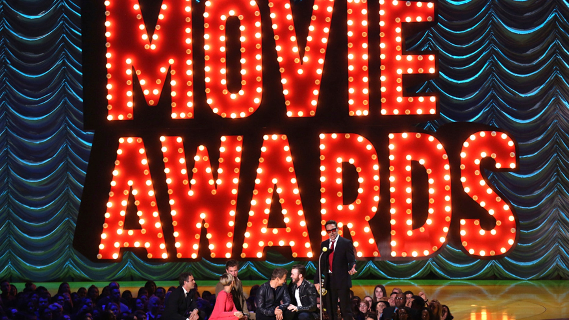 In this April 12, 2015 file photo, Mark Ruffalo, from left, Scarlett Johansson, Chris Hemsworth, Jeremy Renner, and Chris Evans present Robert Downey Jr. with the generation award at the MTV Movie Awards in Los Angeles. MTV announced April 6, 2017, that it has scrapped gender specific categories for its upcoming Movie & TV Awards. This the first year the MTV Movie Awards has been redubbed the Movie & TV Awards.
