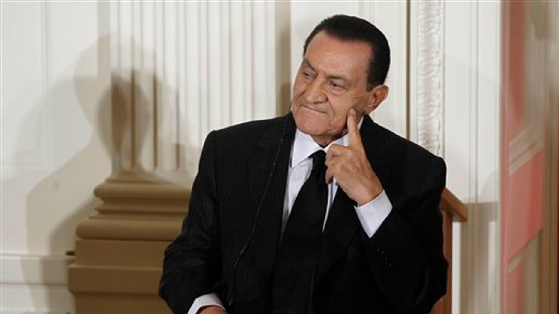 In this Sept. 2010 file photo, Egypt's President Hosni Mubarak listens as Israel's Prime Minister Benjamin Nethanyahu, unseen, speaks in the East Room of the White House in Washington.