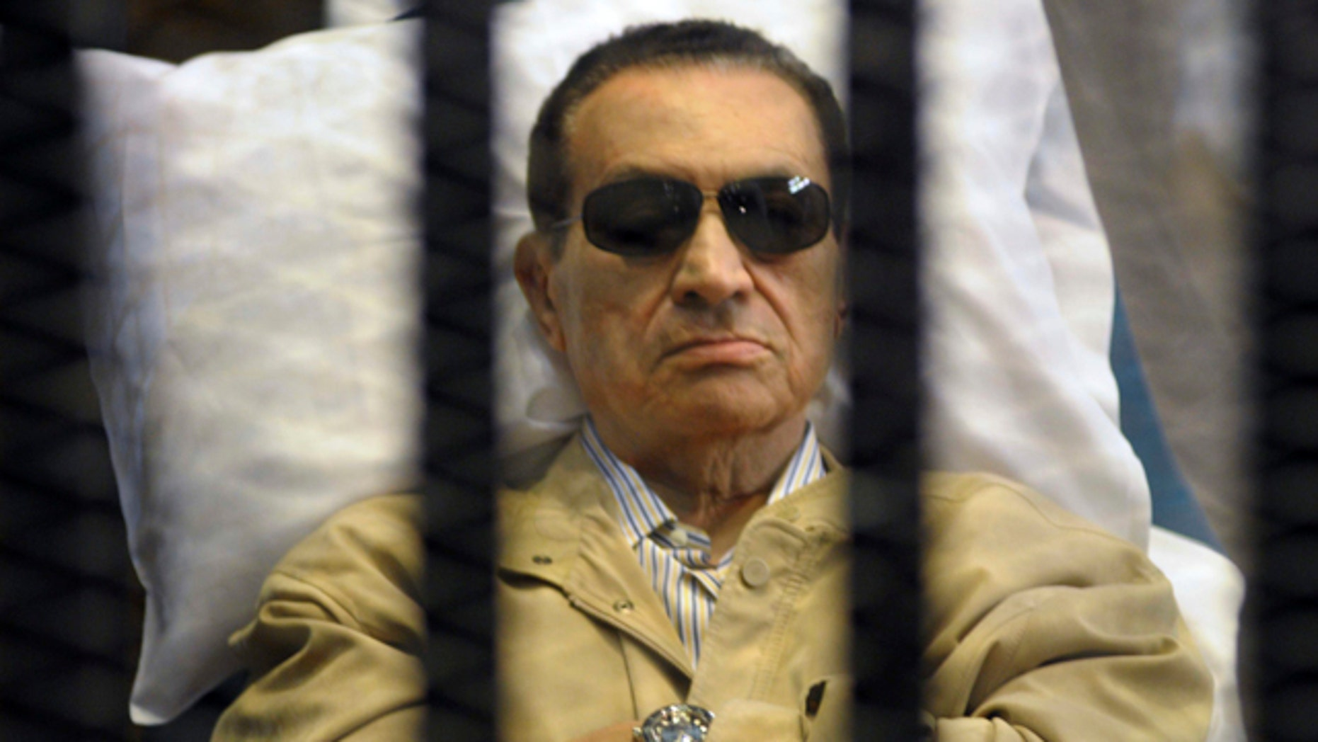 June 2, 2012: Egypt's ex-President Hosni Mubarak lays on a gurney inside a barred cage in the police academy courthouse in Cairo, Egypt.