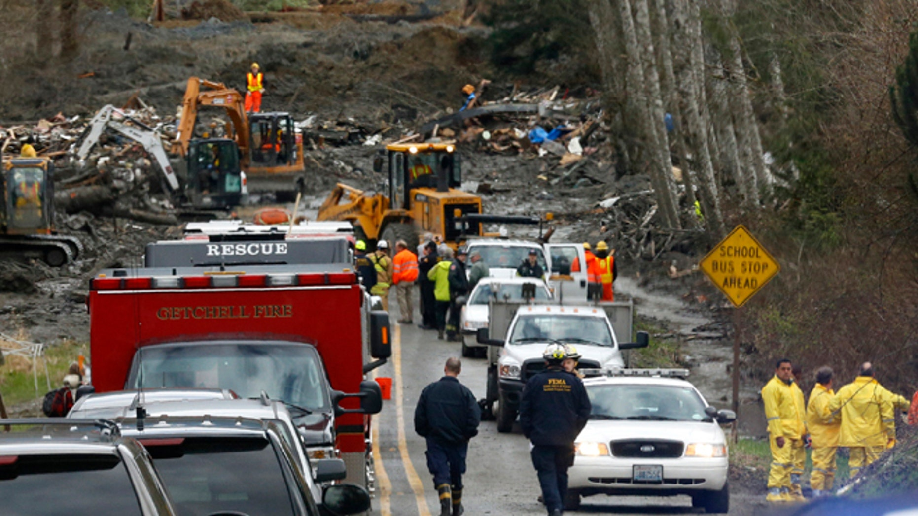 Mar 26, 2014: Workers search the debris that flowed across Highway 530 in the mudslide near Oso, Washington as rescue efforts continue. (Reuters)