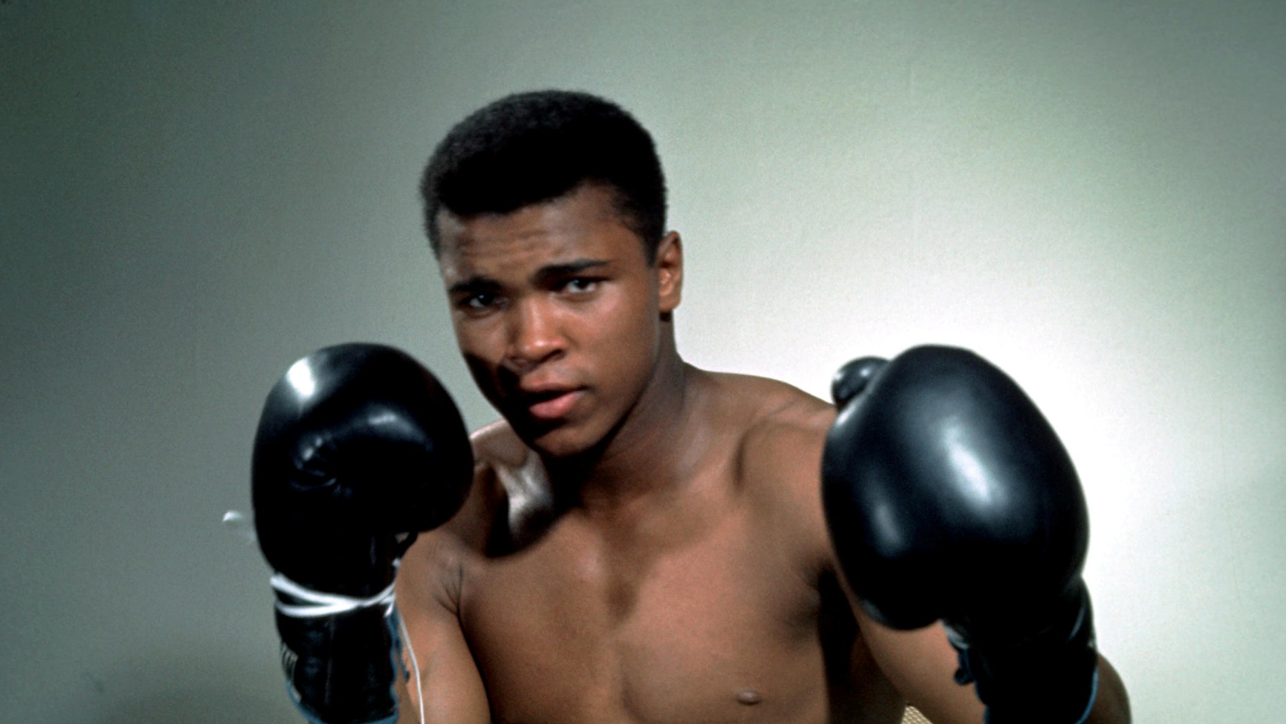 Muhammad Ali poses with gloves in this undated portrait.Mandatory Credit: Action Images / Sporting Pictures/File Photo EDITORIAL USE ONLY. - RTSFZ2A