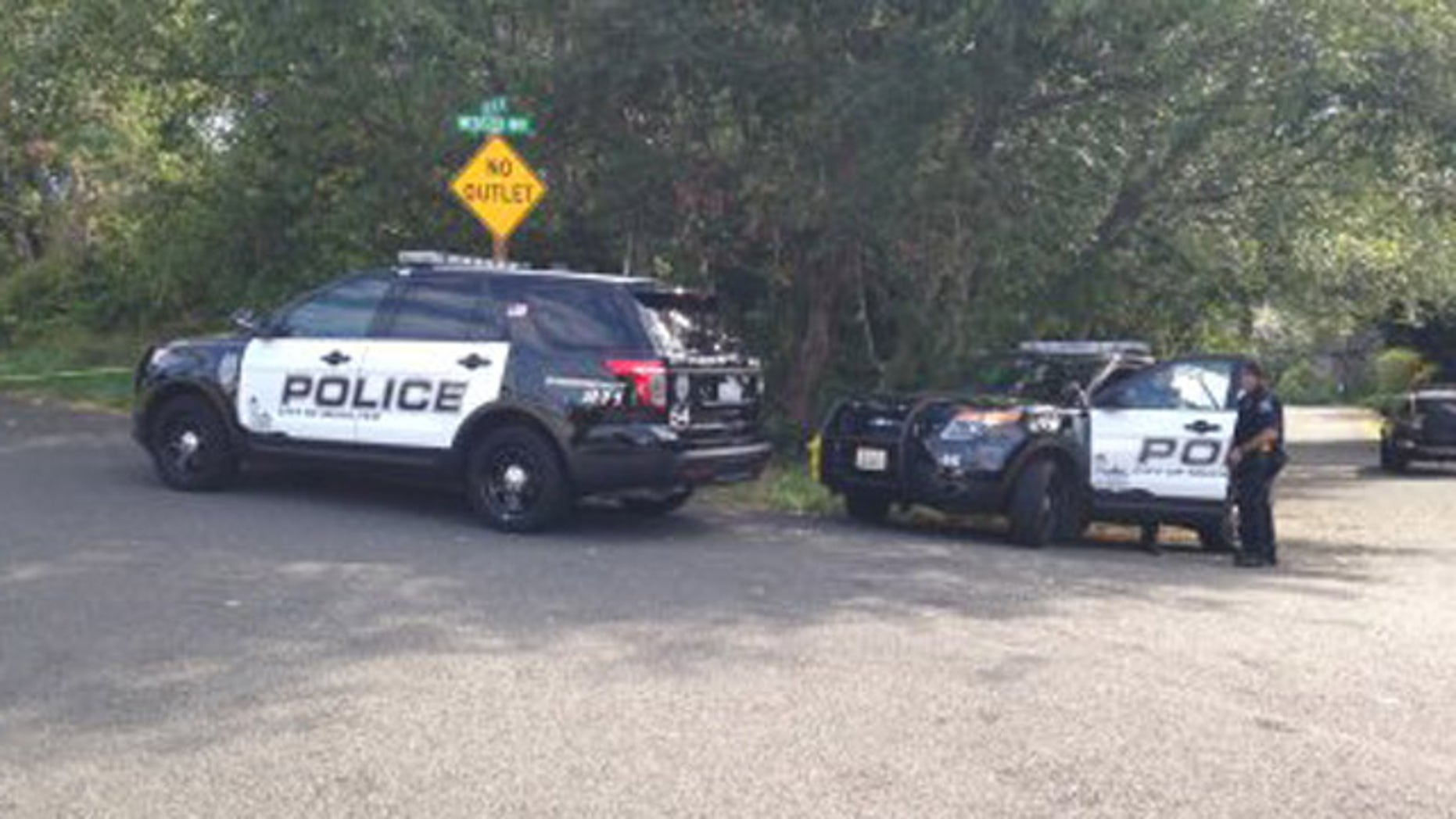 July 30, 2016: Police cars gather at the scene of a deadly shooting in Mukilteo, Wash.
