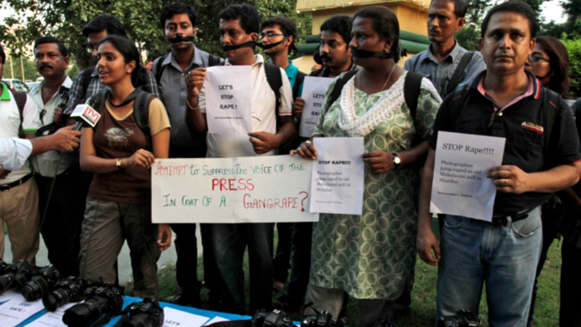 Aug 23, 2013: Indian journalists participate in a protest against the gang rape of a 22-year-old woman photojournalist in Kolkata, India.