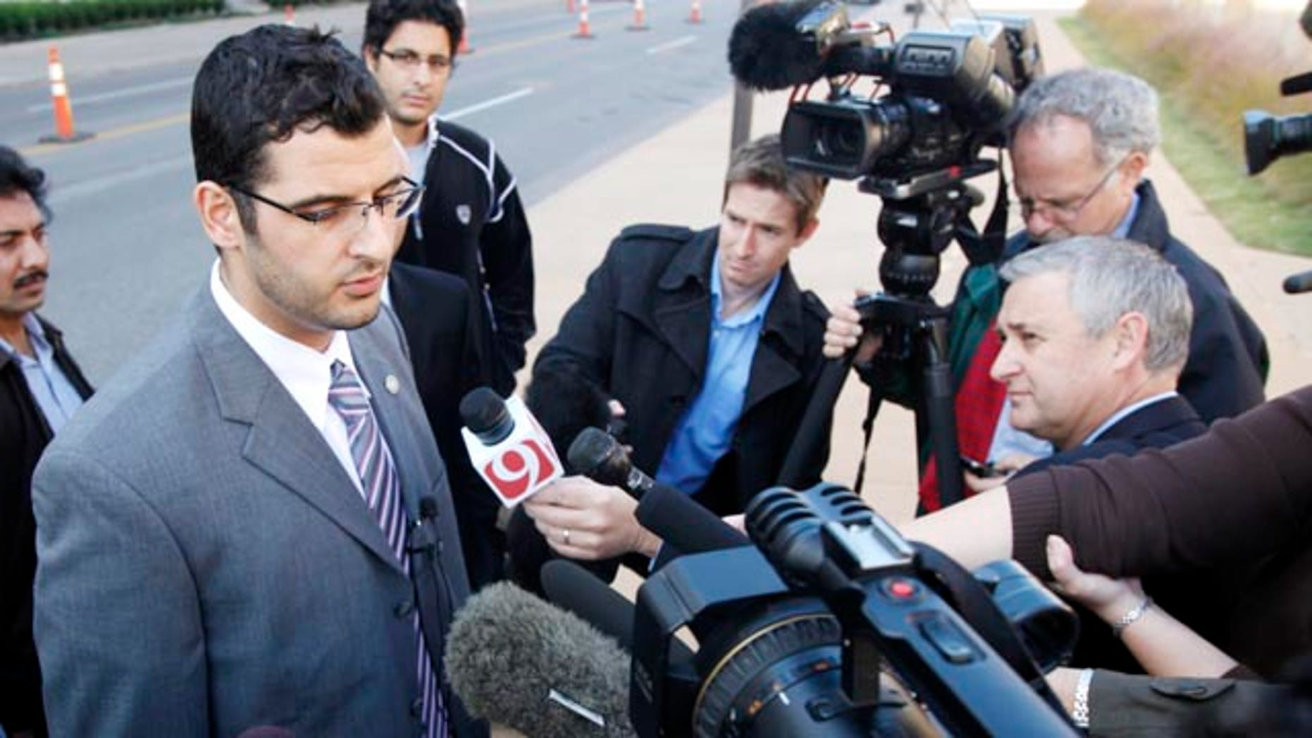 Nov. 8: Muneer Awad, executive director of Council on American-Islamic Relations in Oklahoma, talks to members of the media outside a Federal Courthouse in Oklahoma City. A federal judge in Oklahoma will decide whether to block a constitutional amendment that prohibits state courts from considering international or Islamic law when deciding cases.