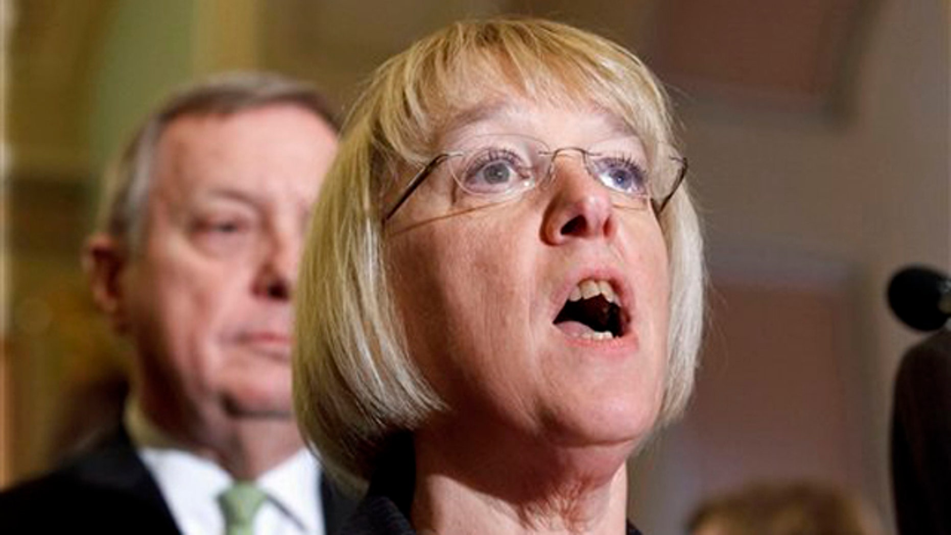 March 1, 2012: Sen. Patty Murray, accompanied by Sen. Richard Durbin, speaks with reporters on Capitol Hill.