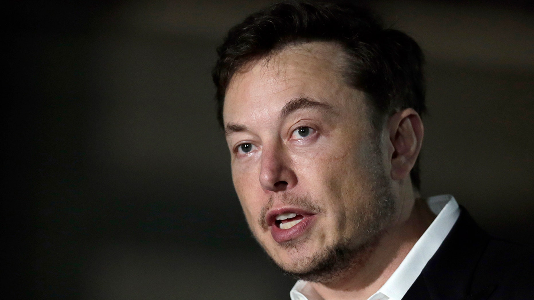 FILE - In this Thursday, June 14, 2018 file photo, Tesla CEO and founder of the Boring Company Elon Musk speaks at a news conference, in Chicago. On Tuesday, July 19, 2018, The Associated Press has found that stories circulating on the internet that Musk announced plans to leave Tesla to start a digital currency company are untrue. (AP Photo/Kiichiro Sato, File)