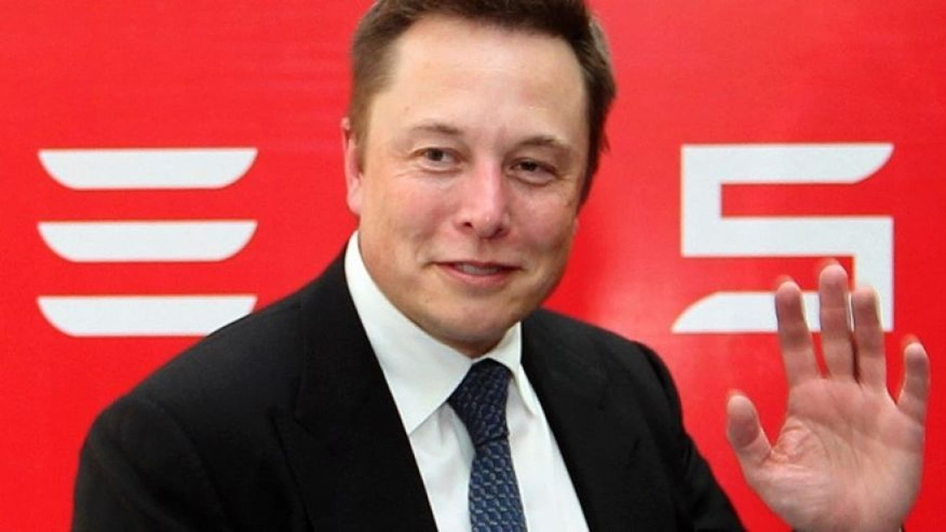 Tesla Chief Executive Elon Musk stands on the podium as he attends a forum on startups in Hong Kong, China January 26, 2016. (REUTERS/Bobby Yip)