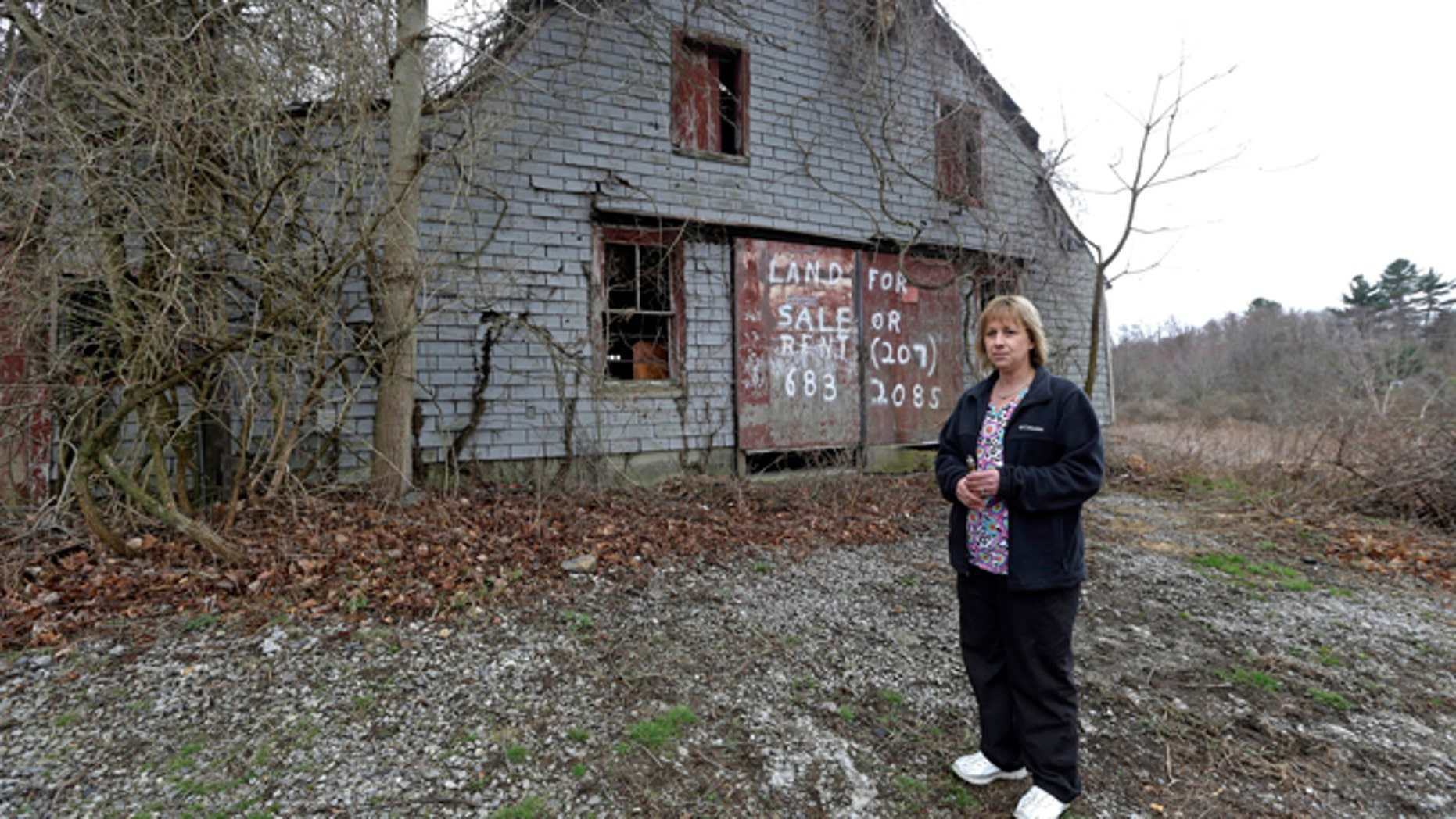 In this April 12, 2016 file photo Desiree Moninski, stands on land located across from her house in Dudley, Mass., which is the site of a proposed Muslim cemetery.