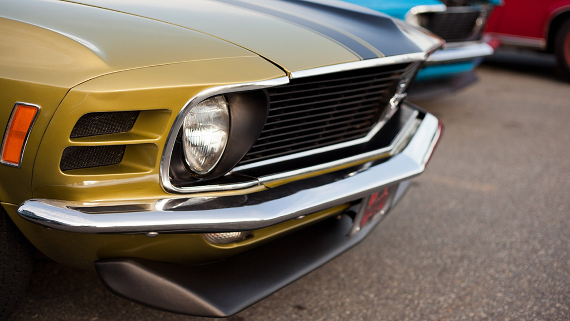 """""""Dartmouth, Nova Scotia Canada - July 19, 2012: A front end shot of a 1970 Ford Mustang antique car in Dartmouth, Nova Scotia, Canada. This classic car was parked by the owner in a parking lot at a local weekly gathering with other classic cars and car enthusiasts."""""""