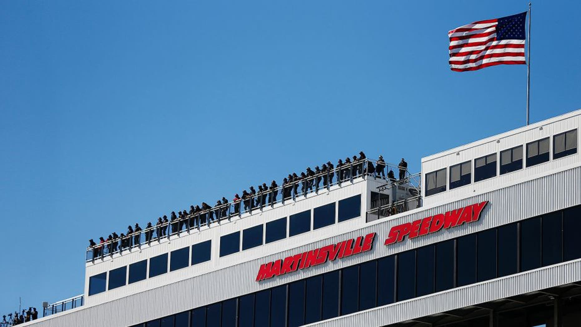 MARTINSVILLE, VA - OCTOBER 30: A general view of spotters on the roof during practice for the NASCAR Camping World Truck Series Kroger 200 at Martinsville Speedway on October 30, 2015 in Martinsville, Virginia. (Photo by Brian Lawdermilk/NASCAR via Getty Images)